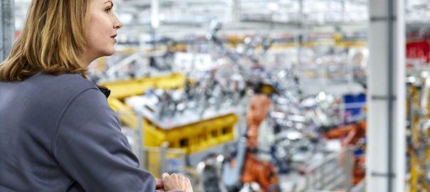woman overlooking lean manufacturing facility